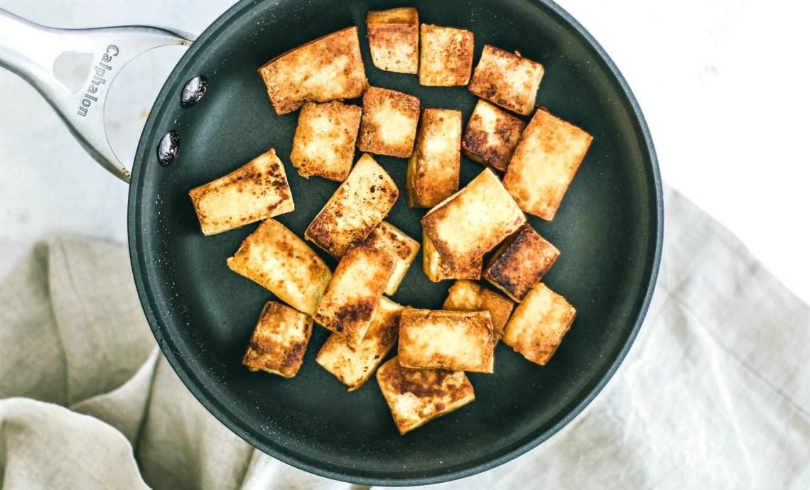 Crispy tofu in a frying pan.