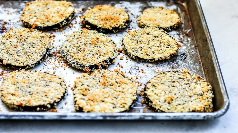 Crispy baked breaded eggplant on a baking sheet.
