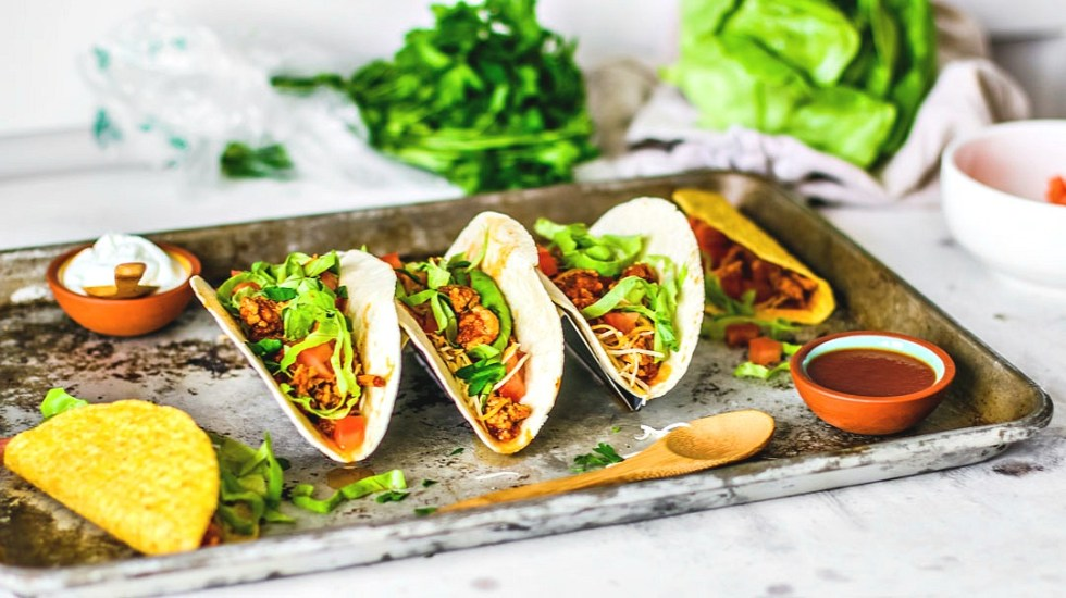 Instant Pot Ground Turkey Tacos laid out on table.