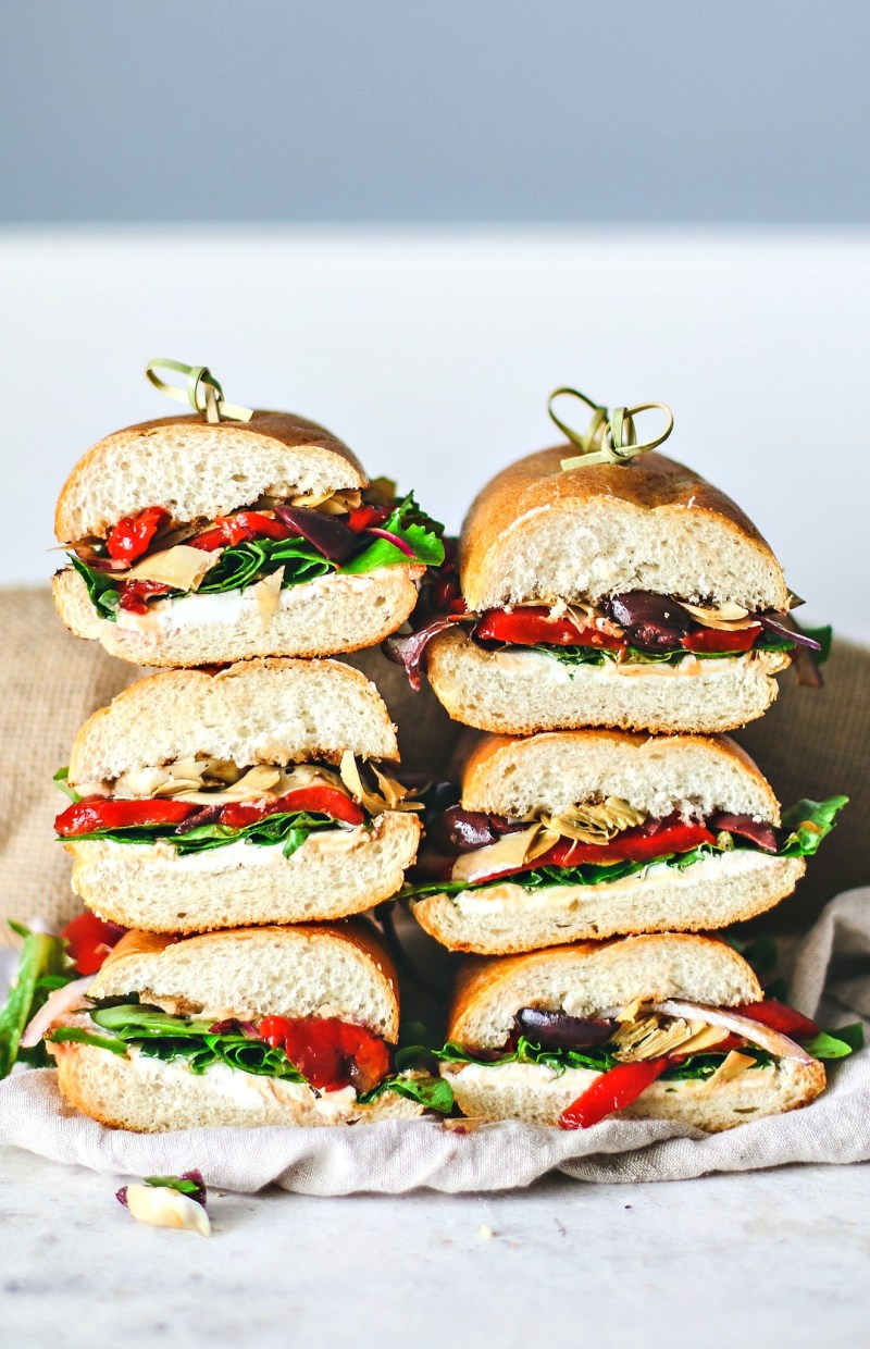 Italian Antipasto Sandwiches cut in halves and stacked.