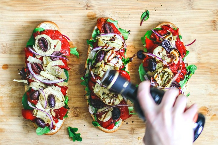 Italian Antipasto Sandwiches being drizzled with balsamic.