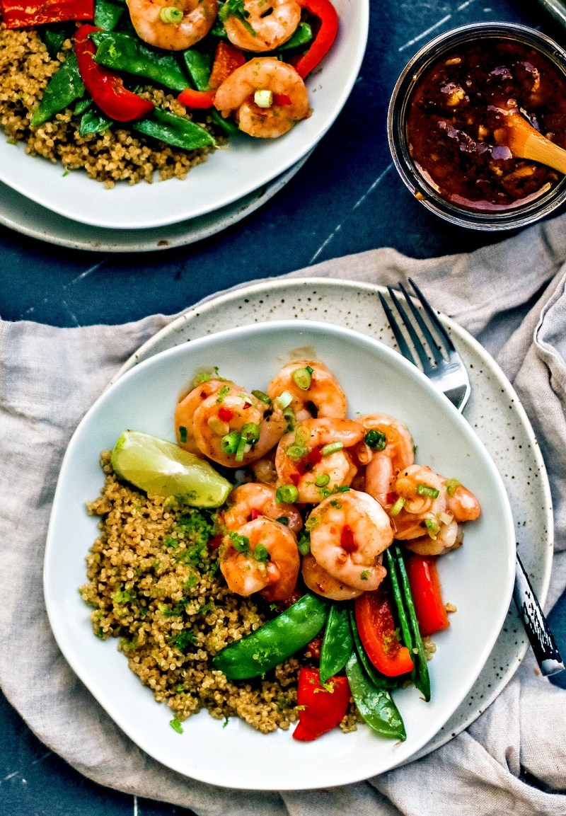 Plate of Spicy Thai Sweet Chili Shrimp with vegetables and quinoa.