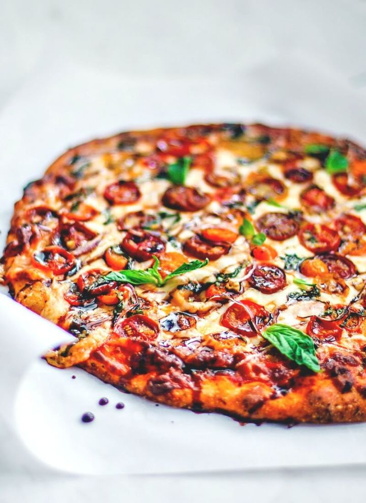 Bruschetta Pizza drizzled with balsamic vinegar.