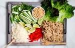 Lettuce wrap ingredients sprawled over platter.