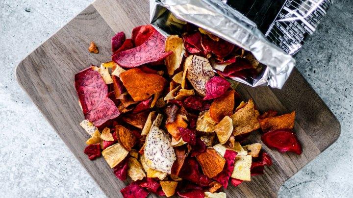 Spilled bag of root vegetable chips.