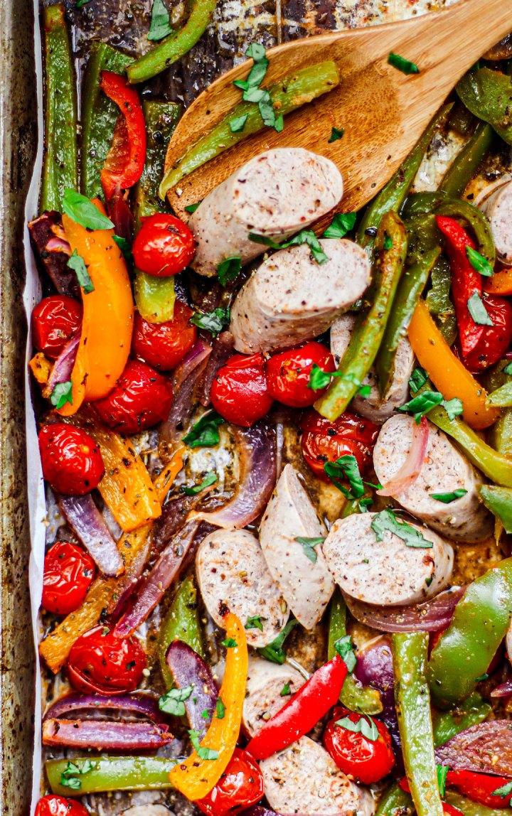 Close up of sheet pan with turkey sausage and veggies.