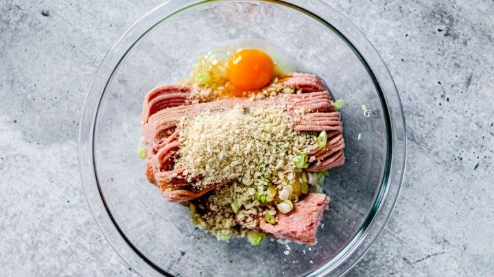 Bowl of raw turkey meatball ingredients.