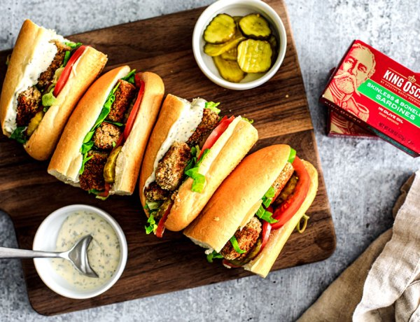 Po'Boy Sandwiches lined up on a cutting board.