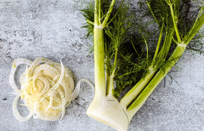 Fennel bulb, partially sliced.