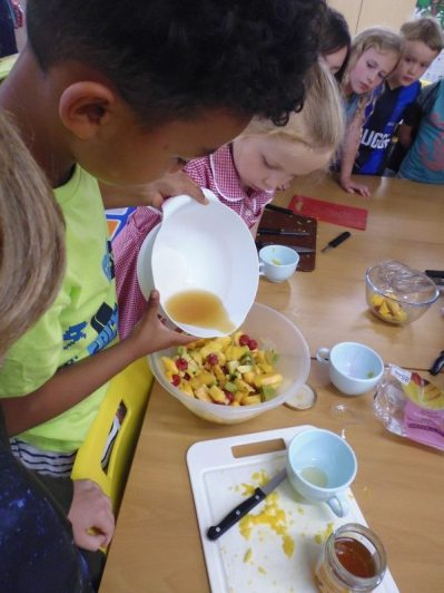 Kate's class making Rainforest Fruit Salad
