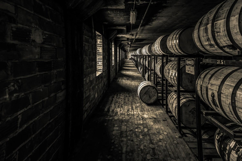 Rows of bourbon barrels