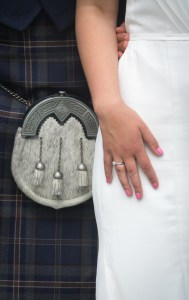Closeup of  Bride and Groom Wearing a Kilt at Wedding in Scotland
