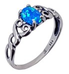 """This is a beautiful ring with lab created blue opal that sparkles. The hearts on the side are the perfect way to say """"I love you"""" or to remind you to love yourself. Made in the U.S.A. Lab created blue opal, Each stone is unique. Metal: Sterling silver"""