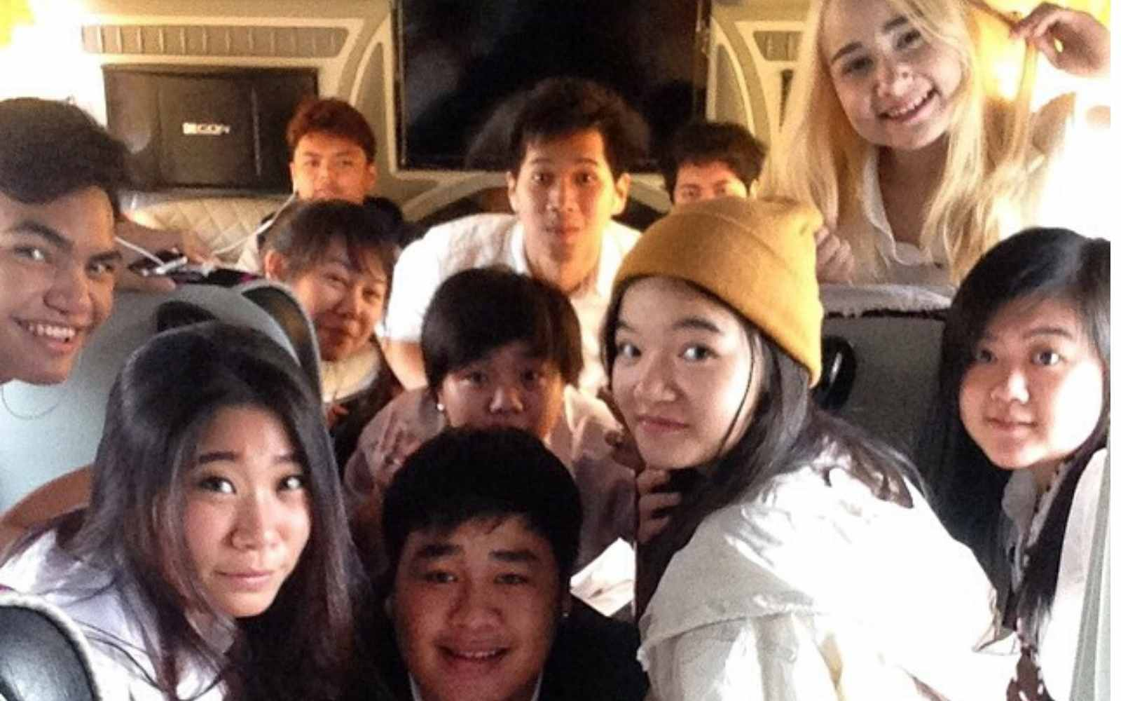 Thai university students on a bus. Difference between Thai culture and America.