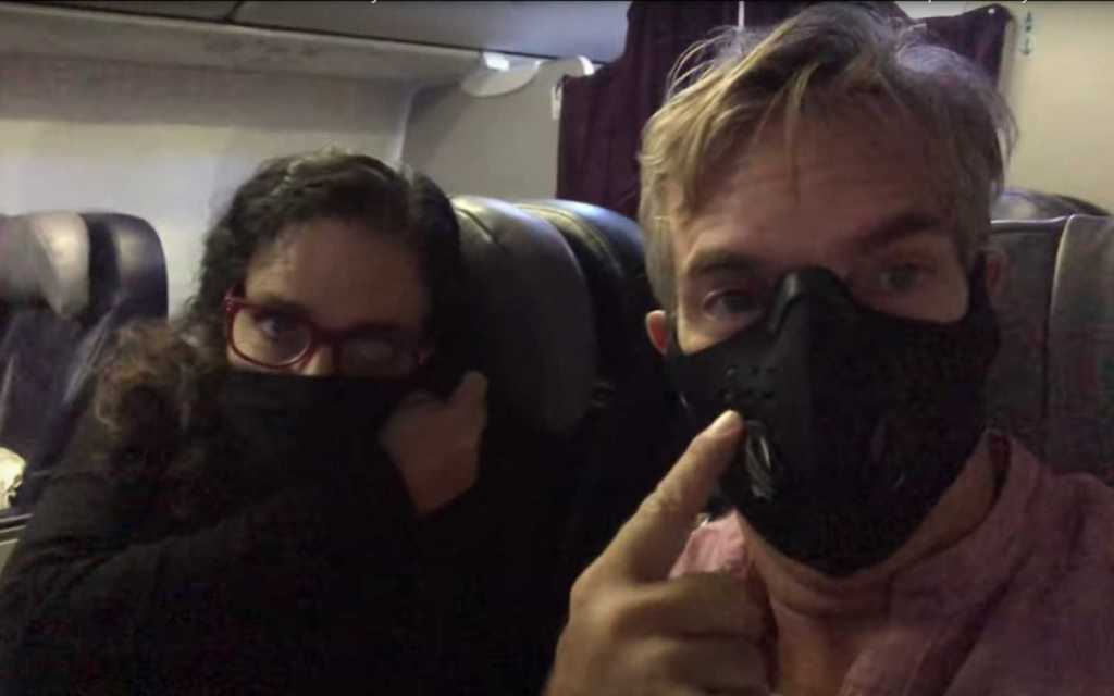 Kim and Way on Malaysia Air wearing masks