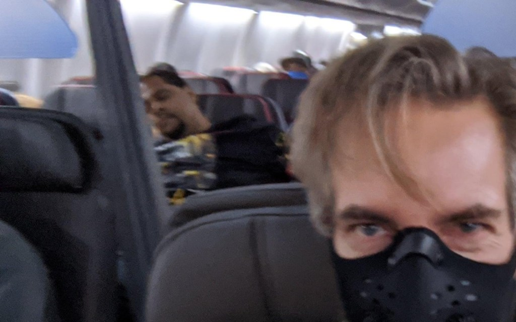 A spreader not wearing his mask on American Airlines