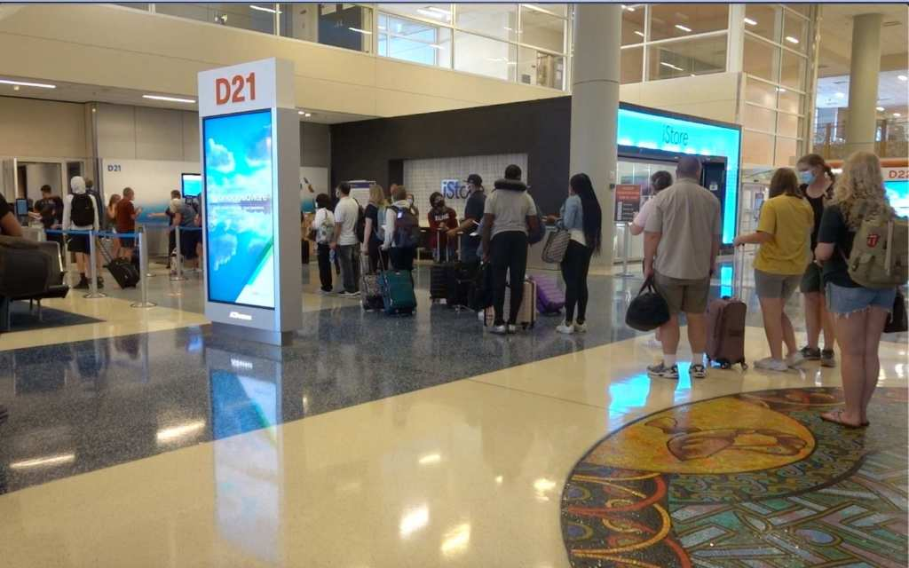People standing in line to board the plane Dallas/Fort Worth International Airport