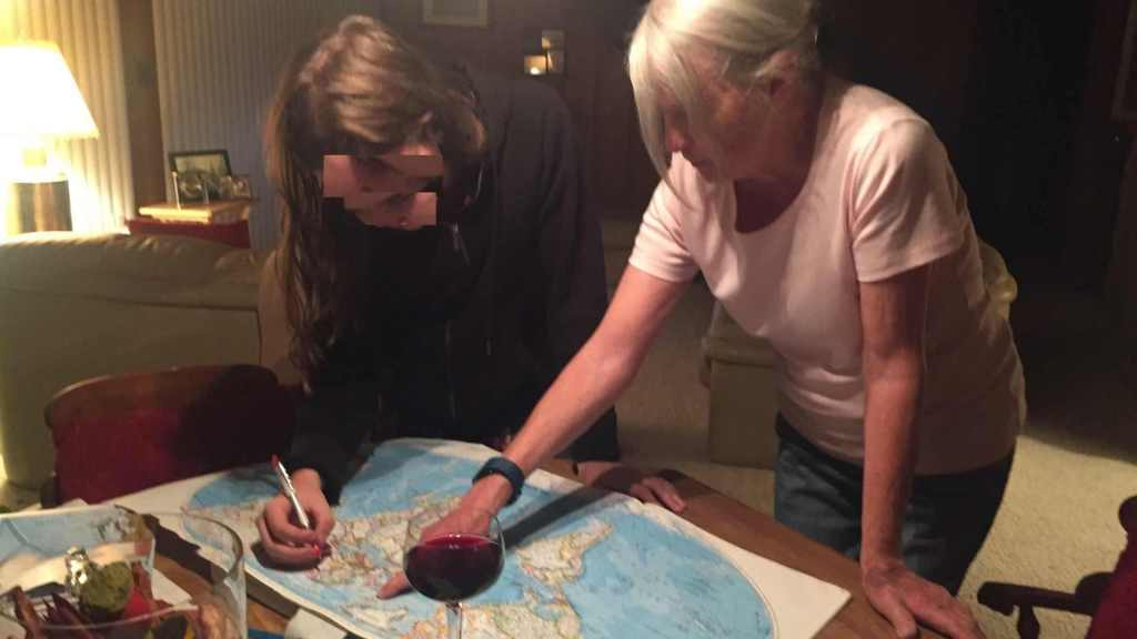 Mom looking at the map with gandson