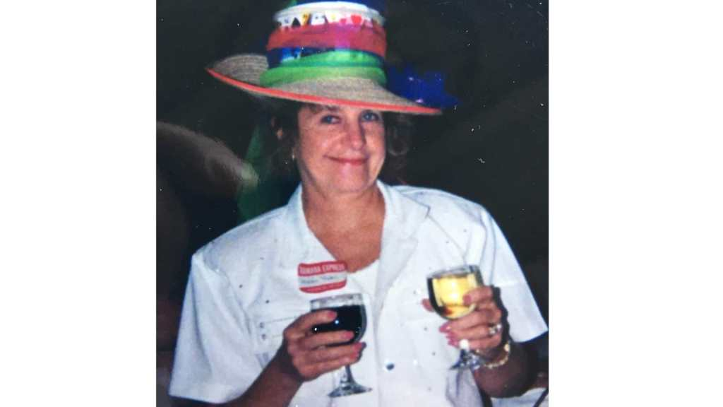 Mom with two drinks and a crazy hat