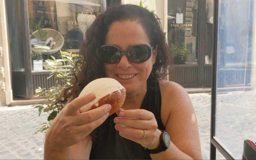 Kim eating a Maritozza in Rome, Italy
