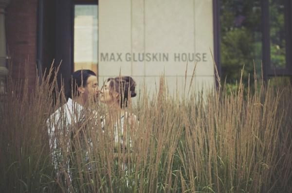 couple-kiss-grass-behind-hidden