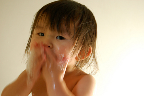 asian baby washing face