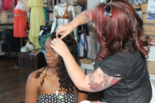 finishing touches on hair backstage beauty dress to impress