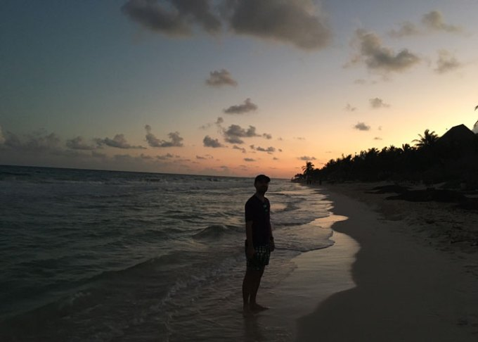 walk on tulum beach at sunset