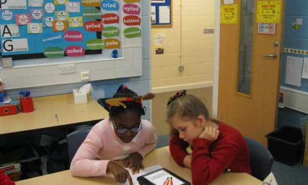 The Year 6s have joined up with the Year3s as a Christmas treat to spend some time reading with them.