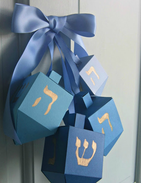 Door decorations - you can find out how to make them here: http://www.designmegillah.com/2015/11/chanukah-door-decor.html