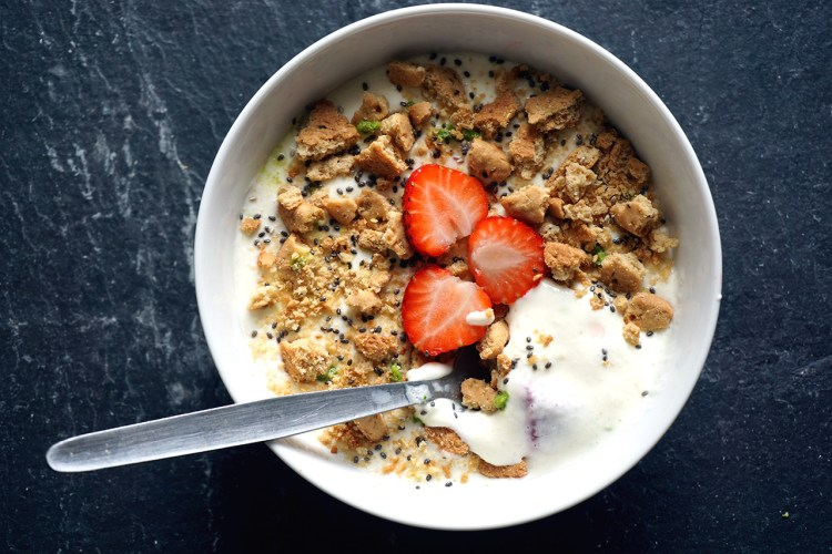 Cheesecake smoothie bowl with strawberries, chia seeds and broken biscuits