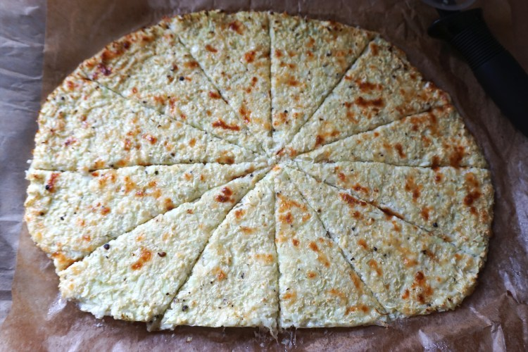 Easy gluten free cauliflower cheese flat bread cut into slices