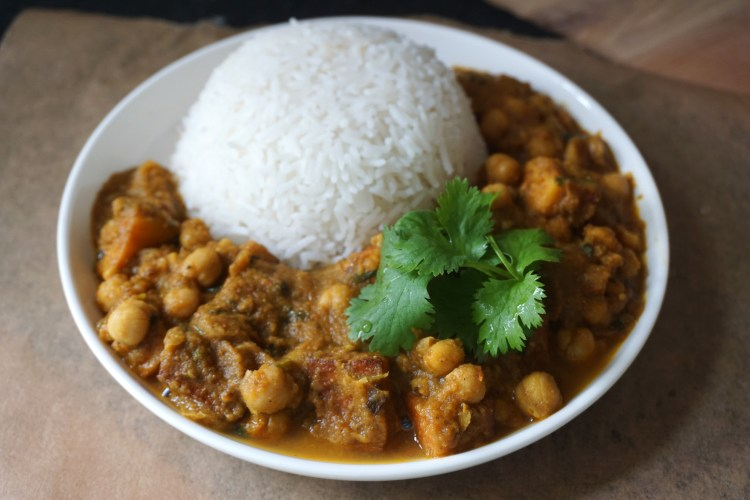 Paneer chana masala with rice and fresh coriander - gluten free vegetarian Indian chickpea curry with added paneer