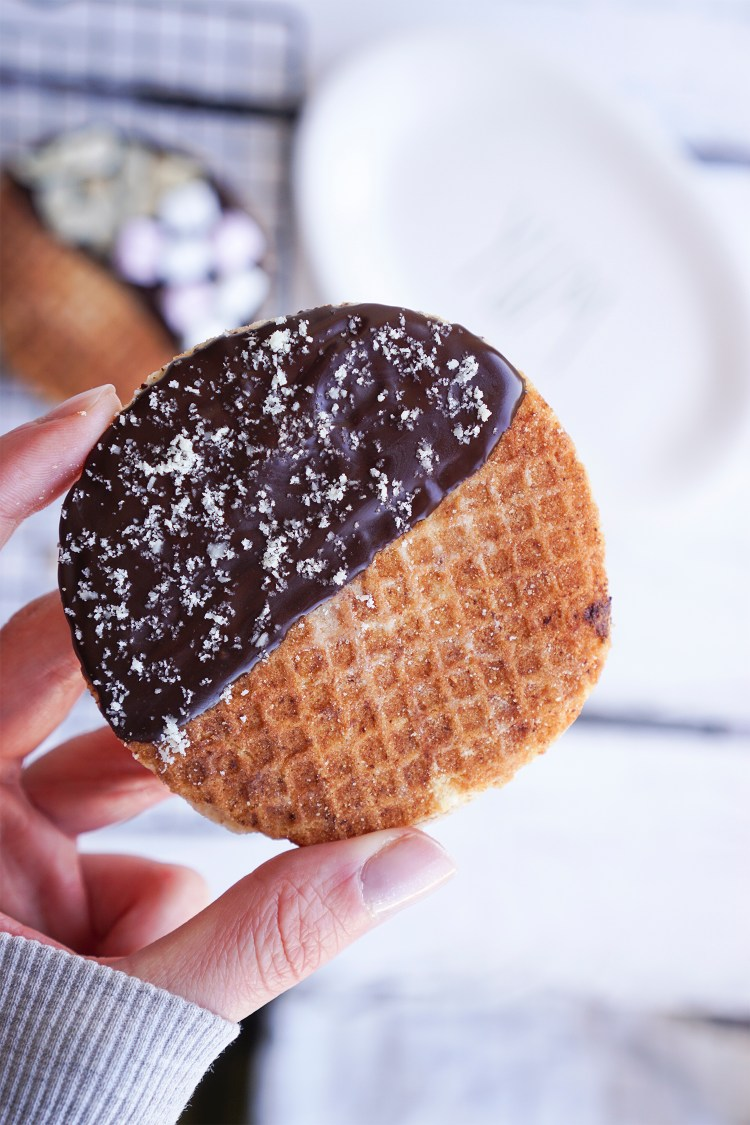 Gluten free stroopwafels dipped in dark chocolate with a sprinkle of ground almonds