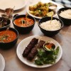 Lamb kebabs + mattar paneer curry + chicky ruby curry + rice + Indian potatoes from Dishoom | Gluten Free | London