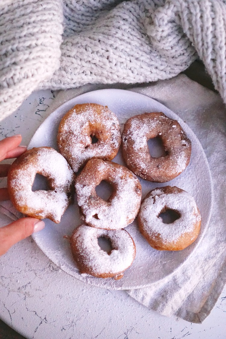 gluten free apple fritter doughnuts covered in icing sugar