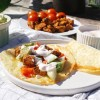 Quick and flourless cheddar cheese taco shells / wraps (low carb, gluten free) with fajita chicken, avocado, bell peppers, onions, cherry tomatoes and sour cream