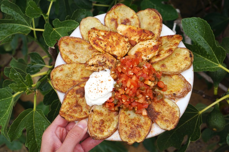 Easy spicy pickled jalapeño salsa with crispy baked potato slices (cottage fries), chicken and yoghurt