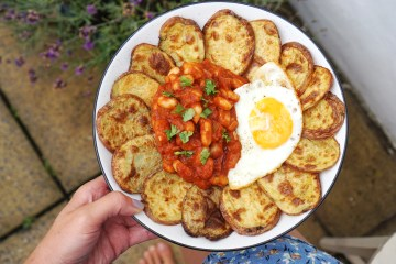 Homemade baked beans / white beans in tomato sauce served with cottage fried (baked potato slices) and a fried egg