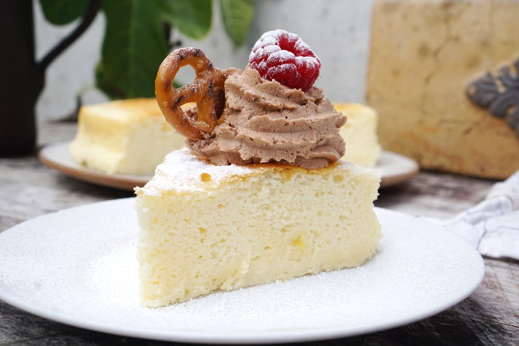 Gluten free soufflé cheesecake / a light & fluffy Japanese sponge cake served with chocolate whipped cream, schar gluten free pretzel, raspberry and icing sugar