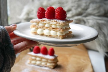 Super quick and easy cream cheese mille feuille made with Just Rol gluten free puff pastry + icing sugar and raspberries on top