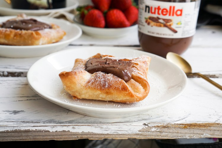 Quick and easy chocolate Danish pastries made using Jus Rol gluten free puff pastry and a big dollop of Nutella - served for breakfast with tea and fresh strawberries