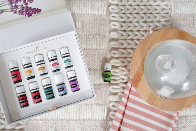 Essential Oils kit from Young Living on a rug near a diffuser