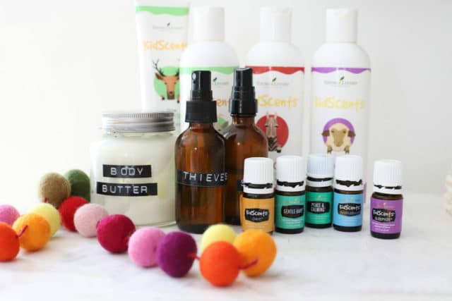 Essential oils for kids and body butter on a counter