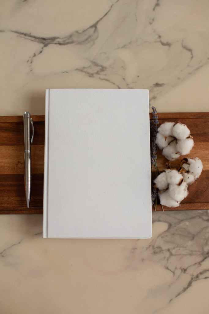 blank notepad with cotton flowers