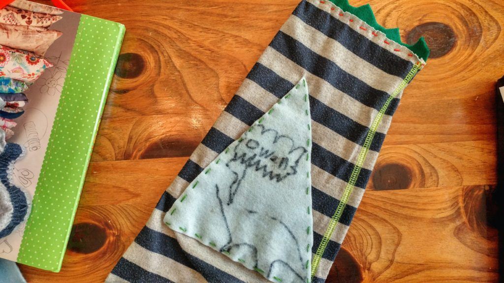 Applique on upcycled pillow from outgrown pajama pants – http://kimwerker.com/blog