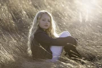 girl sitting in field