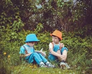 boys in park reading