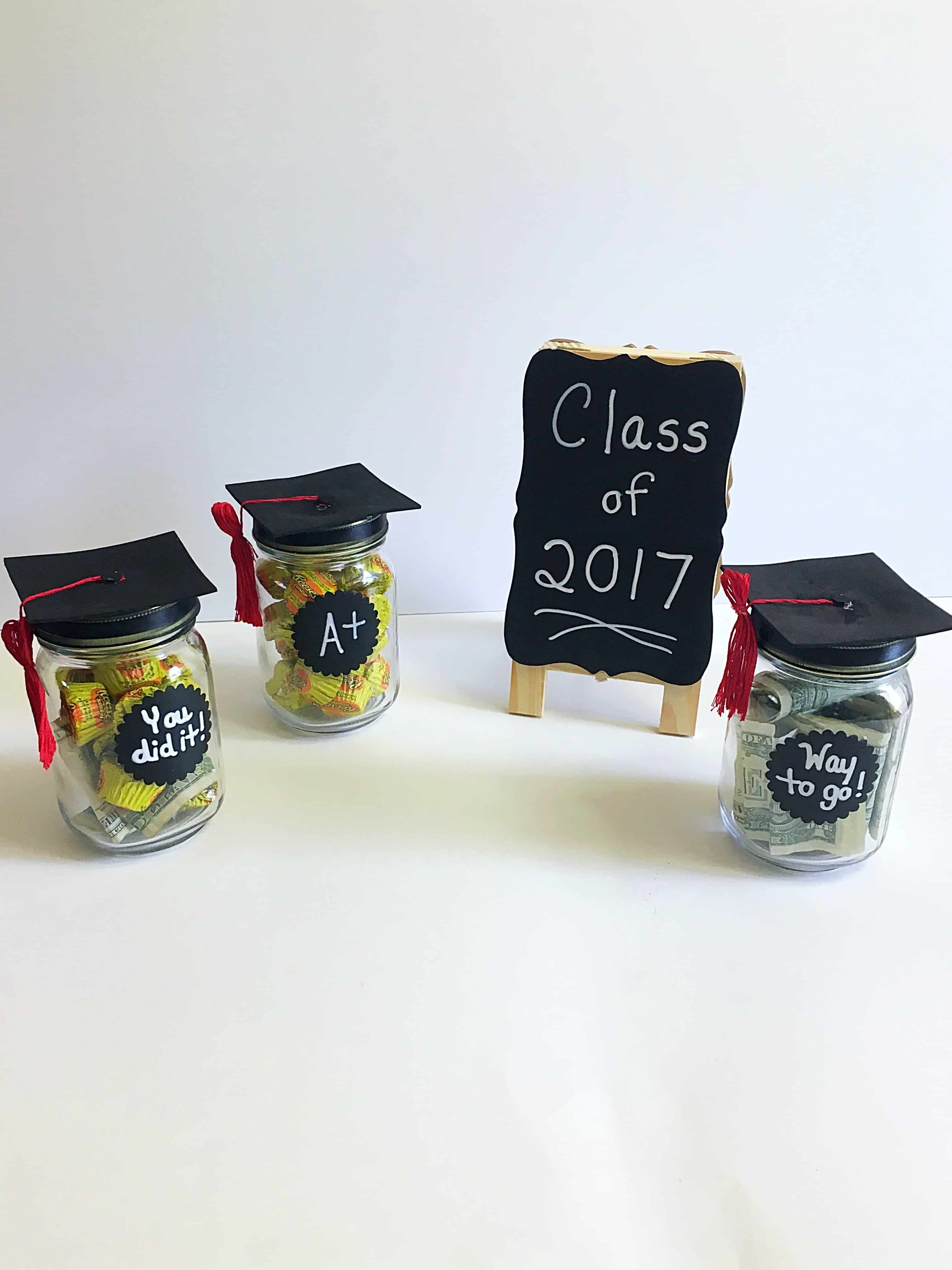 Looking for the perfect graduation gift idea for him or her? These DIY Adorable Graduation Cap Mason Jars are so fun and easy to make and are perfect for gifting to your graduate- whether they're graduating from kindergarten, high school, or college! Get creative and fill up these graduation cap mason jars with dollar bills, candy, or something personal and make your graduate's day unforgettable!#diygraduation #masonjarcrafts