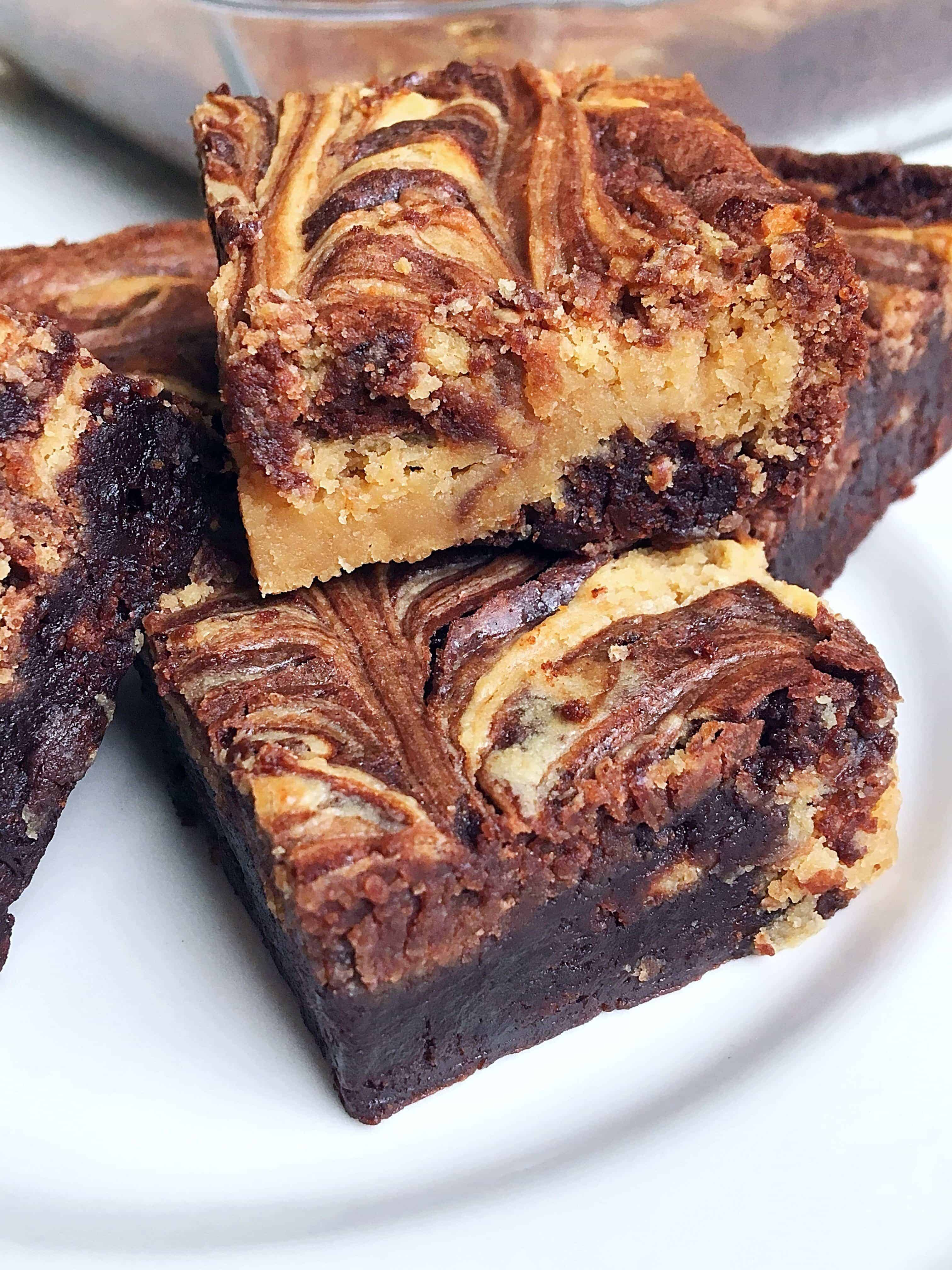 Say goodbye to boring brownies and hello to the most delicious brownies you've ever eaten! Featuring a simple fudge brownie box mix, swirls of decadent peanut butter and sweetened cream cheese mixture, these easy and delicious Peanut Butter Cheesecake Swirl Brownies will quickly become your new favorite dessert recipe to make!
